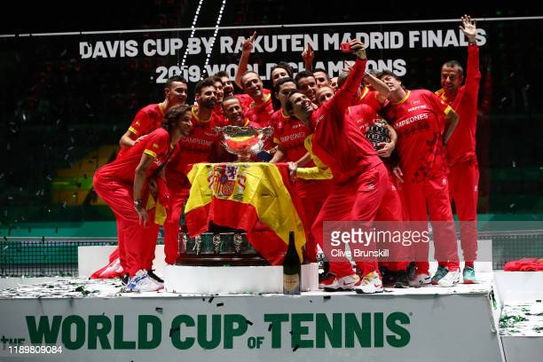 Rafael Nadal of Spain takes a picture with the trophy and his teammates Marcel Granollers Feliciano Lopez Pablo Carreno Busta and Roberto Bautista...
