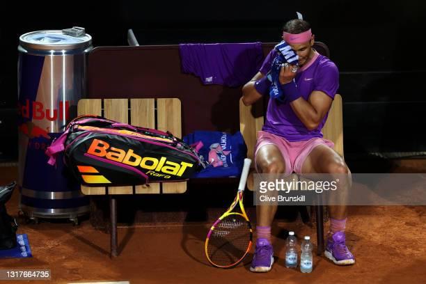 Rafael Nadal of Spain takes break between games on day 5 of the Internazionali BNL d'Italia match between Rafael Nadal of Spain and Jannik Sinner of...