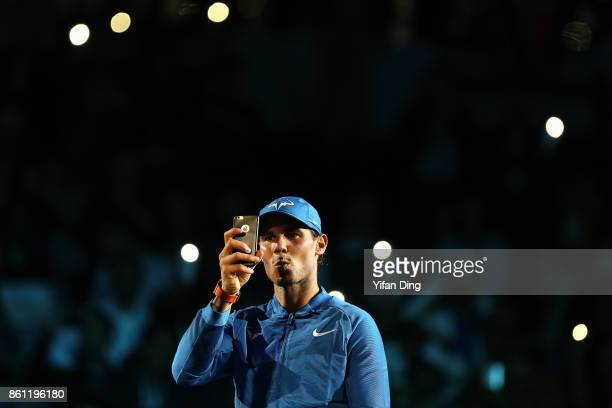 Rafael Nadal of Spain takes pictures after winning his Men's singles semifinal match against Marin Cilic of Croatia on day 7 of 2017 ATP Shanghai...