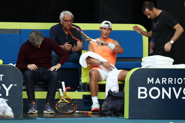 Rafael Nadal of Spain talks to his team during a practice session ahead of the 2021 Australian Open at Melbourne Park on February 06, 2021 in...