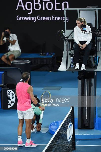 Rafael Nadal of Spain talks to the chair umpire during his Men's Singles Quarterfinal match against Dominic Thiem of Austria on day ten of the 2020...
