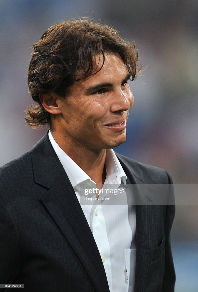 Rafael Nadal of Spain, the 2010 U.S. Open Champion, acknowledges the crowd applauding him prior to the start of the UEFA Champions League group G match between Real Madrid and Ajax at the Estadio Santiago Bernabeu on September 15, 2010 in Madrid, Spain.