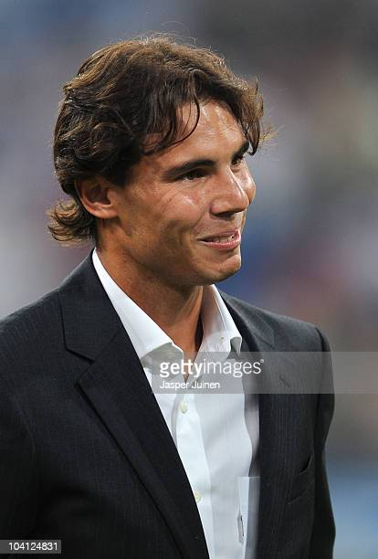 Rafael Nadal of Spain the 2010 US Open Champion acknowledges the crowd applauding him prior to the start of the UEFA Champions League group G match...