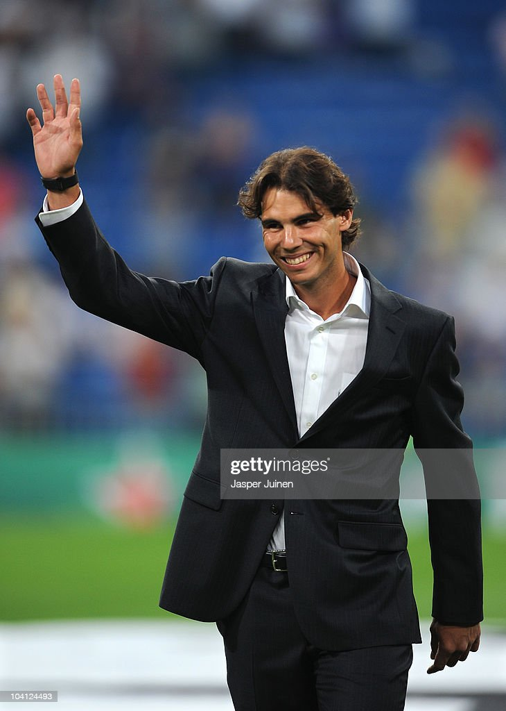 Rafael Nadal of Spain, the 2010 U.S. Open Champion, acknowledges the crowd prior to the start of the UEFA Champions League group G match between Real Madrid and Ajax at the Estadio Santiago Bernabeu on September 15, 2010 in Madrid, Spain.