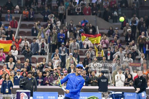 Rafael Nadal of Spain throws balls to the audience after his Men's Singles Semifinal match against Grigor Dimitrov of Bulgaria on day eight of 2017...