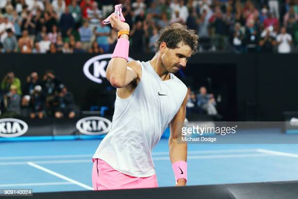 Rafael Nadal of Spain throws his headband in frustration after he pulled out in the fifth set due to an injury in his quarterfinal match against...