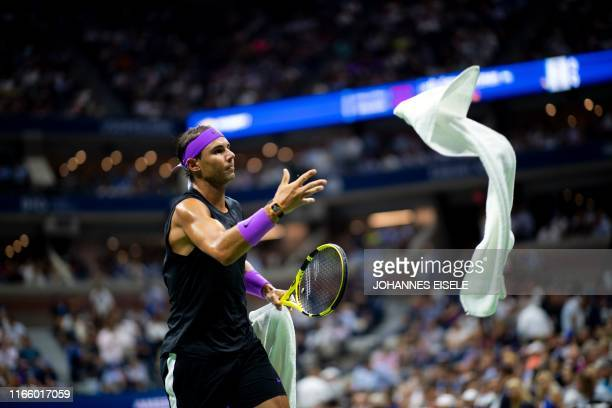 Rafael Nadal of Spain throws his towel after a point against Diego Schwartzman of Argentina during their Men's Singles Quarterfinals match at the...