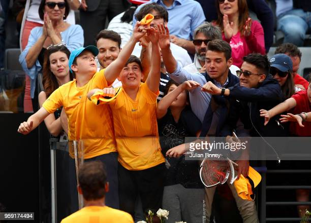 Rafael Nadal of Spain throws his wrist band into the crowd as he celebrates defeating Damir Dzumhur Bosnia during day four of the Internazionali BNL...