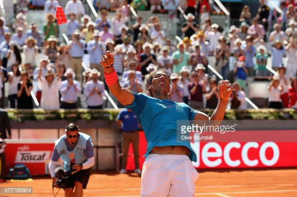 Rafael Nadal of Spain throws his wristband to the crowd after his straight sets victory against Tomas Berdych of the Czech Republic in their semi...