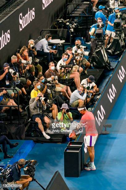 Rafael Nadal of Spain towels down during his Men's Singles Quarterfinals match against Stefanos Tsitsipas of Greece during day 10 of the 2021...