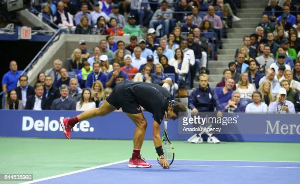 Rafael Nadal of Spain tries to move away a butterfly inside the field at the Arthur Ashe Stadium during Men's Singles SemiFinal tennis match against...