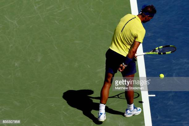 Rafael Nadal of Spain tugs at his shorts before serving to Albert RamosVinolas of Spain during day 7 of the Western Southern Open at the Lindner...