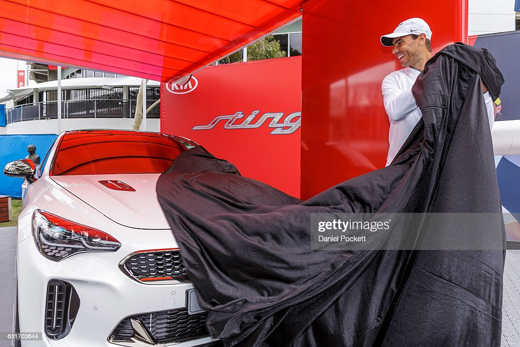 Rafael Nadal of Spain unveils a Kia Stinger during a Kia Key handover ceremony at Garden Square in Melbourne Park January 15, 2017 in Melbourne, Australia.