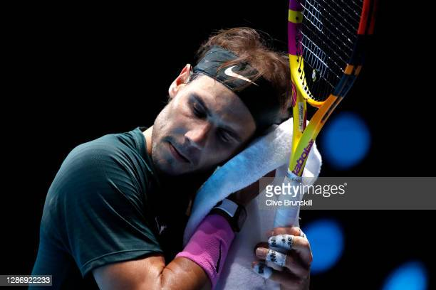 Rafael Nadal of Spain uses the towel during his singles semi final match against Daniil Medvedev of Russia during day seven of the Nitto ATP World...
