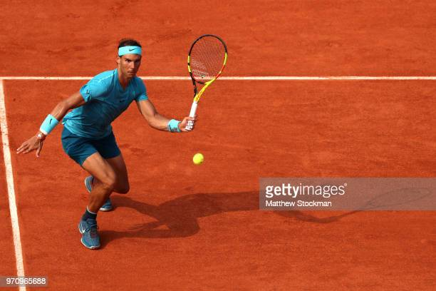 Rafael Nadal of Spain volleys during the mens singles final against Dominic Thiem of Austria during day fifteen of the 2018 French Open at Roland...