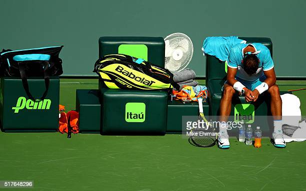 Rafael Nadal of Spain waits for a doctor before retiring during a match against Damir Dzumhur of Bosnia and Herzegovina during Day 6 of the Miami...