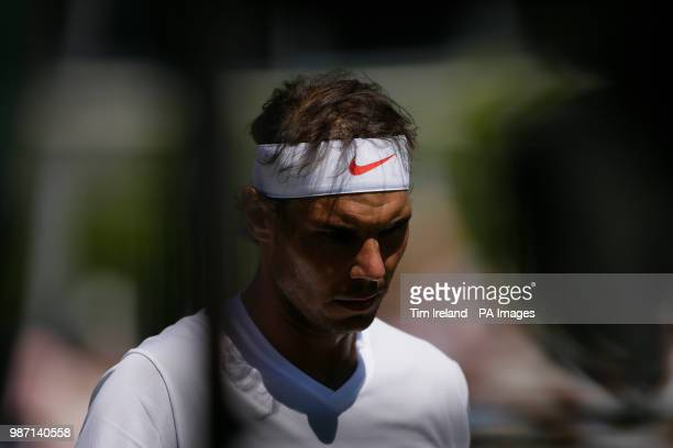 Rafael Nadal of Spain walks back to his chair during his match with Lucas Pouille of France during day four of the Aspall Classic at the Hurlingham...