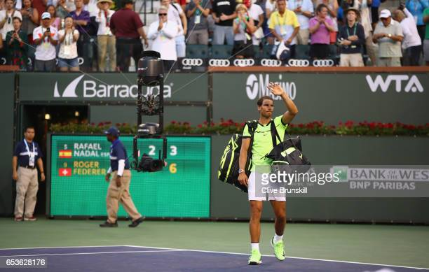 Rafael Nadal of Spain walks off court after his straight sets defeat by Roger Federer of Switzerland in their fourth round match during day ten of...