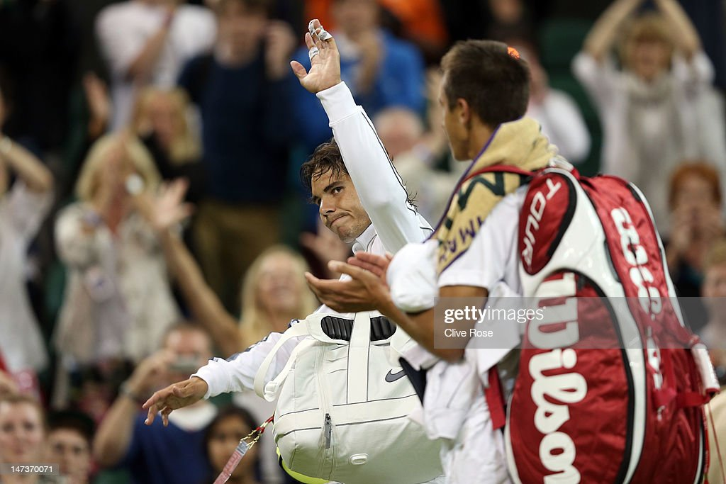 Rafael Nadal of Spain (L) walks off the court after being defeated by Lukas Rosol of the Czech Republic during their Gentlemen's Singles second round match on day four of the Wimbledon Lawn Tennis Championships at the All England Lawn Tennis and Croquet Club on June 28, 2012 in London, England.