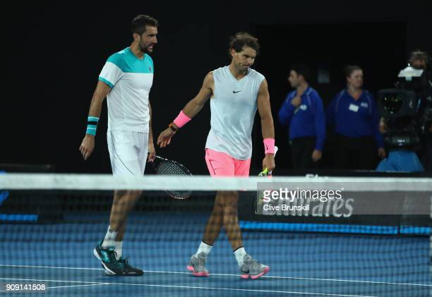 Rafael Nadal of Spain walks off the court after shaking hands because of retiring injured during the fifth set in his quarterfinal match against...