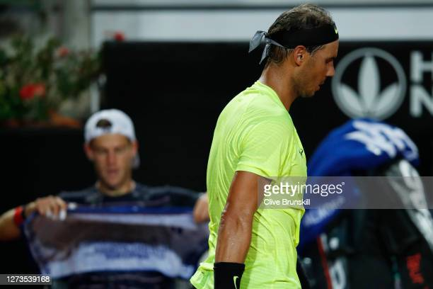 Rafael Nadal of Spain walks past Diego Schwartzman of Argentina as they change ends during their quarterfinal match during day six of the...