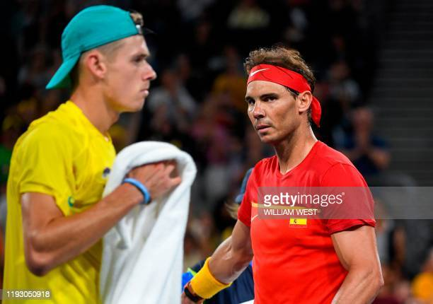 TOPSHOT Rafael Nadal of Spain walks to his end during his men's singles match against Alex de Minaur of Australia at the ATP Cup tennis tournament in...