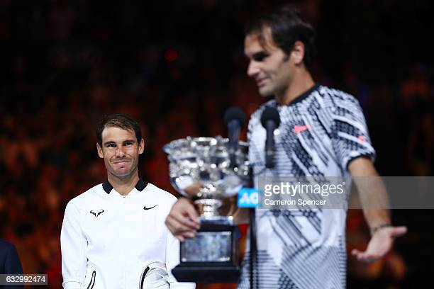 Rafael Nadal of Spain watches on as Roger Federer of Switzerland holds the trophy after winning their Men's Final match on day 14 of the 2017...