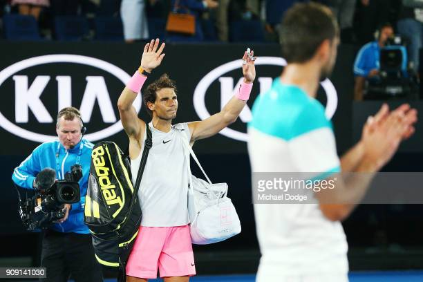 Rafael Nadal of Spain waves to the crowd after he pulled out in the fifth set due to an injury in his quarterfinal match against Marin Cilic of...