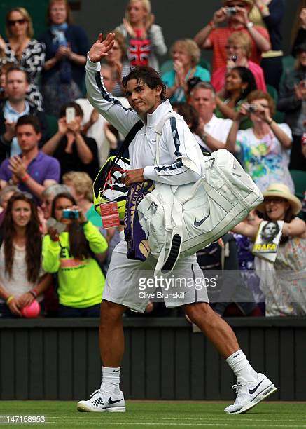 Rafael Nadal of Spain waves to the crowd after winning his Gentlemen's Singles first round match against Thomaz Bellucci of Brazil on day two of the...