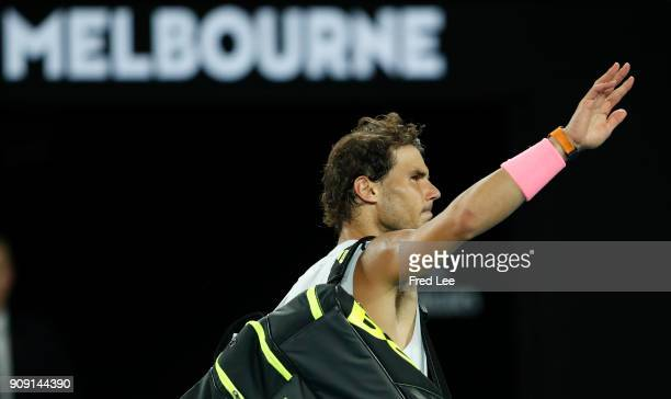 Rafael Nadal of Spain waves to the crowd as he leaves the court after retiring with an injury in his quarterfinal match against Marin Cilic of...
