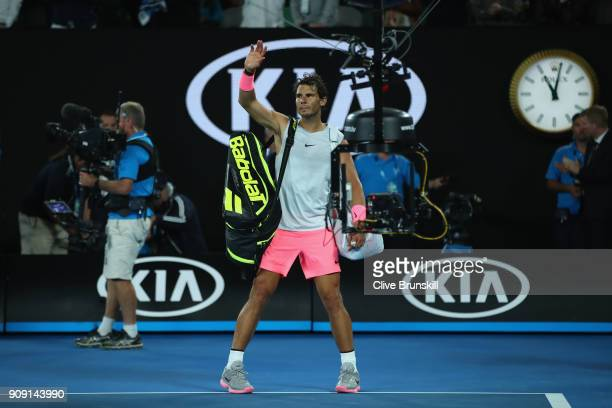 Rafael Nadal of Spain waves to the crowd as he walks off the court after retiring injured during the fifth set in his quarterfinal match against...