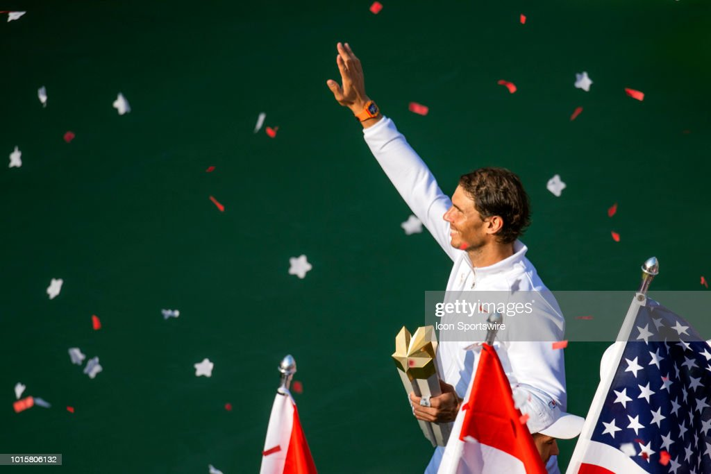 Rafael Nadal of Spain waves to the crowd through the confetti holding the Rogers Cup Trophy as he celebrates his victory over Stefanos Tsitsipas of Greece after their Men's Final match at the Rogers Cup Sunday, August 12, 2018 at Aviva Centre in Toronto, Ontario Canada. Nadal defeated Tsitsipas 6-2, 7-6.