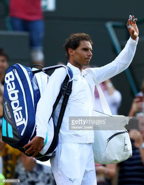 Rafael Nadal of Spain waves to the fans after the Gentlemen's Singles first round match against John Millman of Australia on day one of the Wimbledon...
