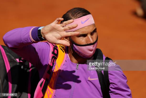 Rafael Nadal of Spain waves to the fans as he comes onto court before his semi-final match with Reilly Opelka of USA on Day Eight of the...