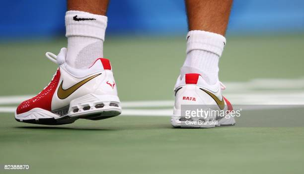 Rafael Nadal of Spain wears his personalized tennis shoes while taking on Fernando Gonzalez of Chile during the men's singles gold medal tennis match...