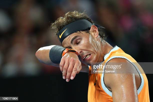 Rafael Nadal of Spain wipes his face in his Men's Singles Final match against Novak Djokovic of Serbia during day 14 of the 2019 Australian Open at...