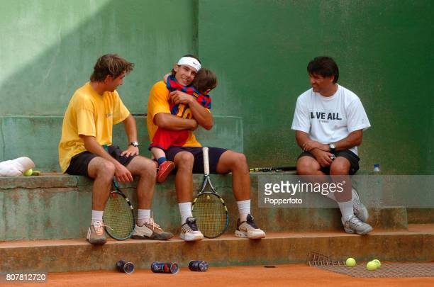 Rafael Nadal of Spain with his Coach and Uncle Toni Nadal taking a break during a practice session at the 'Club Tenis Manacor' in Majorca Spain where...