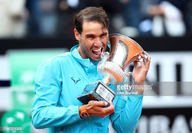 Rafael Nadal of Spain with his winners trophy after his three set victory against Novak Djokovic of Serbia in the men's final during day eight of the...