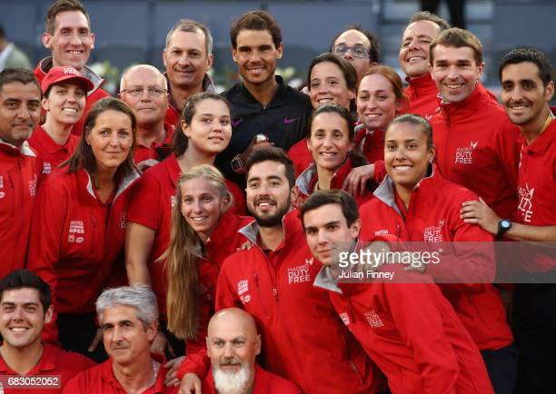 Rafael Nadal of Spain with the winners trophy alongside the groundstaff after his win over Dominic Thiem of Austria in the final during day nine of...