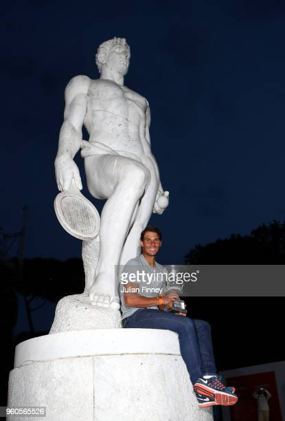 Rafael Nadal of Spain with the winners trophy by a statue after his win over Alexander Zverev of Germany in the final during day eight of the...