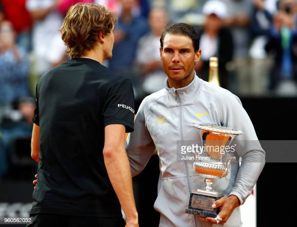 Rafael Nadal of Spain with the winners trophy next to runner up Alexander Zverev of Germany after the final during day eight of the Internazionali...