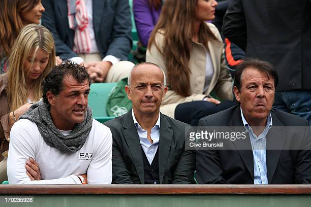 Rafael Nadal of Spain's father Sebastian Nadal and uncle Miguel Nadal watch his Men's Singles final match against David Ferrer of Spain during day...