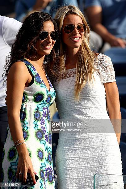 Rafael Nadal of Spain's girlfriend Xisca Perello poses with his sister Isabel Nadal before his men's singles final match against Novak Djokovic of...