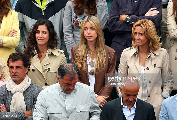Rafael Nadal of Spain's girlfriend Xisca Perello sister Isabel Nadal and mother Ana Maria Parera watch his Men's Singles final match against David...