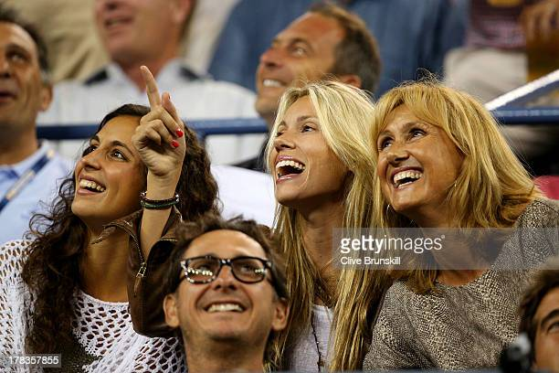 Rafael Nadal of Spain's girlfriend Xisca Perello sister Isabel Nadal and mother Ana Maria Parera laugh during his men's singles second round match...