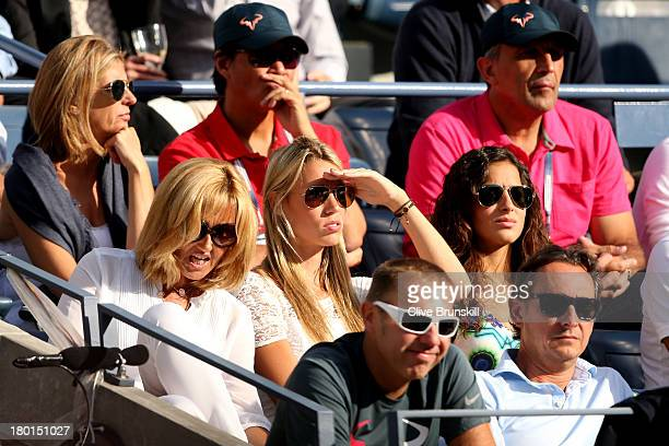 Rafael Nadal of Spain's mother Ana Maria Parera sister Isabel Nadal and girlfriend Xisca Perello watch his men's singles final match against Novak...