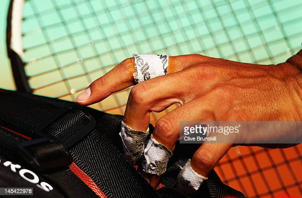 Rafael Nadal of Spain's taped fingers as he packs his racquets into his bag after his men's singles first round match against Simone Bolelli of Italy...