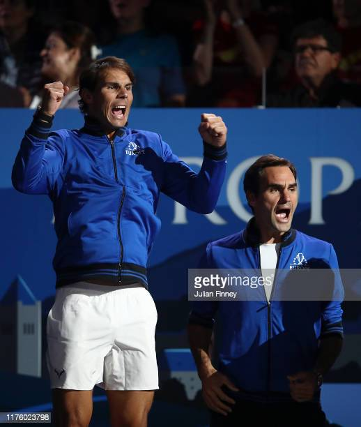 Rafael Nadal of Team Europe and teammate Roger Federer celebrate during the singles match between Stefanos Tsitsipas of Team Europe and Taylor Fritz...