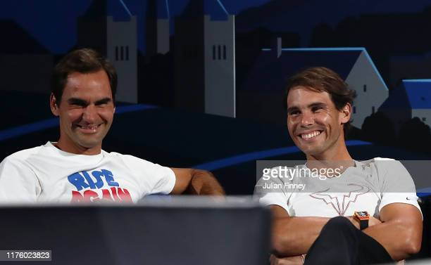 Rafael Nadal of Team Europe and teammate Roger Federer share a joke during the singles match between Stefanos Tsitsipas of Team Europe and Taylor...