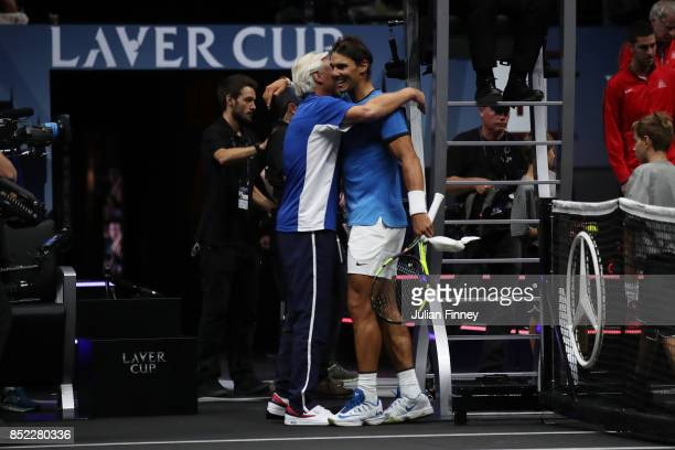 Rafael Nadal of Team Europe celebrates with Bjorn Borg Captain of Team Europe after winning his singles match against Jack Sock of Team World on Day...